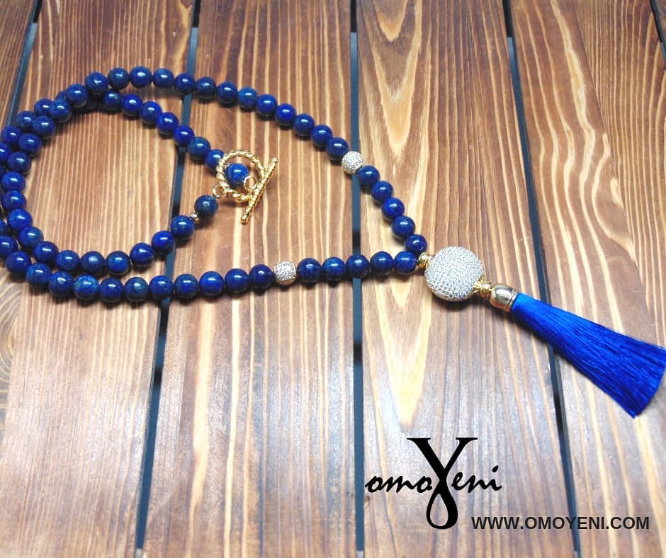 Tassel necklace with lapis beads accented with CZ pave spacers